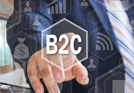 The businessman chooses  B2C, Business-to-consumer on the touch screen with a futuristic background .The concept B2C, Business-to-consumer . Stock Photo
