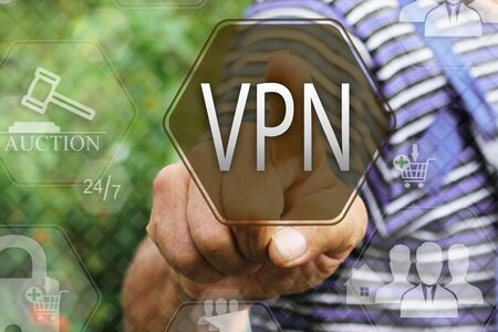 Elderly businessman, the farmer chooses  a VPN on the touch screen. Virtual private network web tag.Ð¡oncept internet technology.