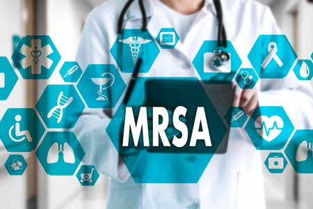 Medical Doctor with stethoscope and word MRSA ,Methicillin-Resistant Staphylococcus Aureus in Medical network connection on the virtual screen on hospital background.Technology and medicine concept.