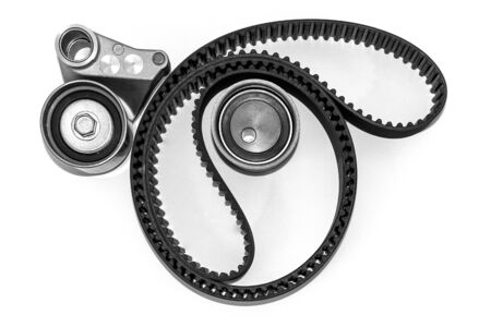Spare parts for the car. Kit of timing belt with rollers on a light background. Foto de archivo - 125076939