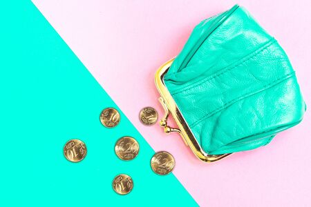 Purse for coins. A leather purse, wallet on a Geometric pink and turquoise background