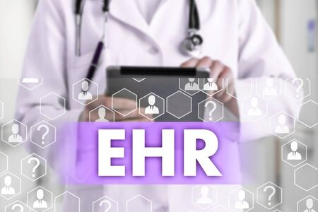 Electronic health record. EHR on the touch screen with medicine icons on the background blur Doctor in hospital.Innovation treatment, service, data analysis health. Medical Healthcare Concept Electronic health record, EHRound Reklamní fotografie