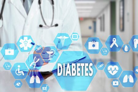 Medical Doctor with stethoscope and Diabetes icon in Medical network connection on the virtual screen on hospital background Reklamní fotografie