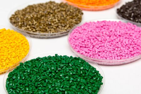 Plastic pellets .Polymeric dye в granules. The recycling of plastic. Granular colored plastic granules.
