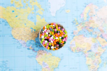 Plastic pellets on the background of the world map .The concept of Plastic pollution. The concept of world environment day.Selective focus Stock fotó - 138602449