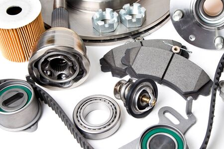 New car parts background .Hub, pump, brake pads, filter, timing belt, rollers, cv joints, thermostat for cars isolated on white background