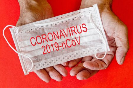 Coronavirus  2019 -nCoV . An elderly man is holding a mask. Selective focus. Coronavirus outbreak awareness.