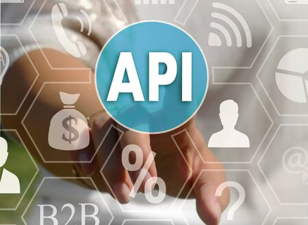 Businesswoman pushes a button API, Application Programming Interface on the touch screen Stock Photo