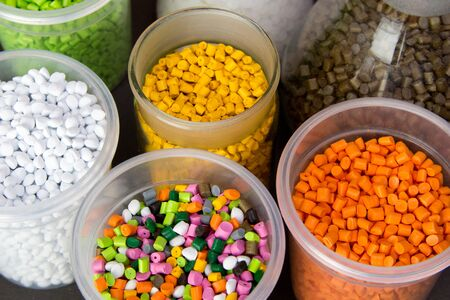 Plastic granules in a measuring container and test tubes in the laboratory. Plastic pellets. Dyes for plastic, polypropylene, polyethylene Stock Photo