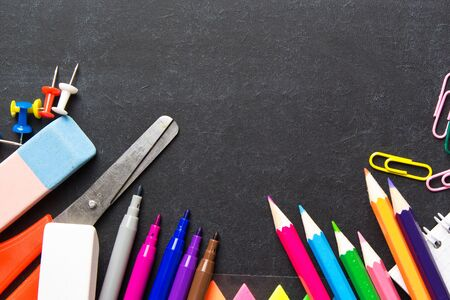 School supplies on blackboard background . The concept of education, study, learning, elearning. Back to school Фото со стока