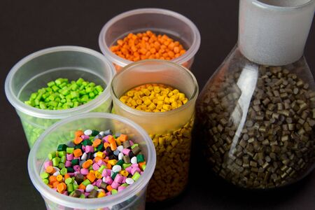 Plastic granules in a measuring container and test tubes in the laboratory. Plastic pellets. Plastic Raw material . BPA FREE Stock Photo