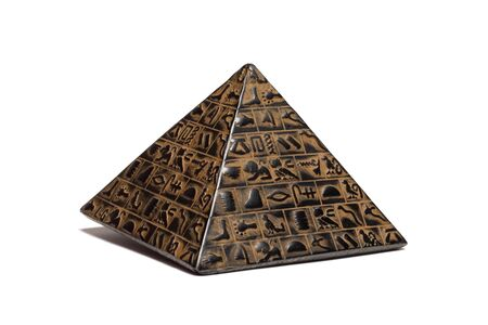 beautiful pyramid figurine stands on a white background close-up