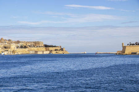 Deep sea view to the two lighthouses of Grand Harbor, Malta with part of Valletta and the sentry box of Gardjola Gardens in Senglea Stock Photo