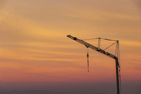 Skyscape with a construction crane against a beautiful autumn sunset sky in Sofia, Bulgaria