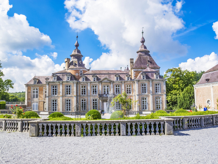 MODAVE, BELGIUM - SEPTEMBER 02, 2015: Modave Castle or Castle of the Counts of Marchin against a beautiful cloudy sky, front facade