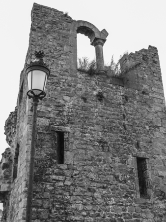 Hollow Tooth on the Bock rock- the remains of a tower of one of the fortress gates in Luxembourg City, Grand Duchy of Luxembourg, black and white