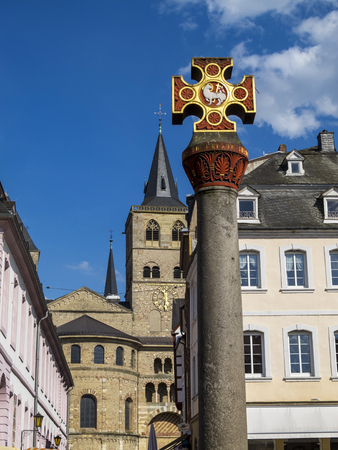 The Market Cross at the Main Market in Trier - the oldest city in Germany, the Cathedral of Saint Peter in the back