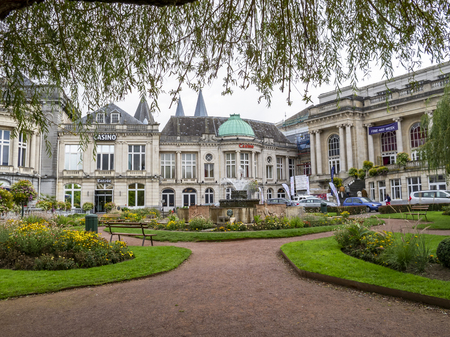 SPA, BELGIUM - SEPTEMBER 29, 2013: View to the present buildings of the 18th-century La Redoute - the oldest Casino in the world with the Gardens of the Casino and the fountain in front 新闻类图片