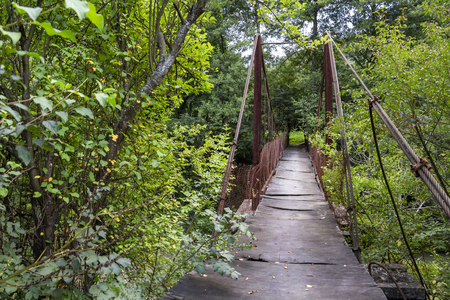 Old suspension footbridge in disrepair outside the Bulgarian Fore-Balkan village of Debnevo