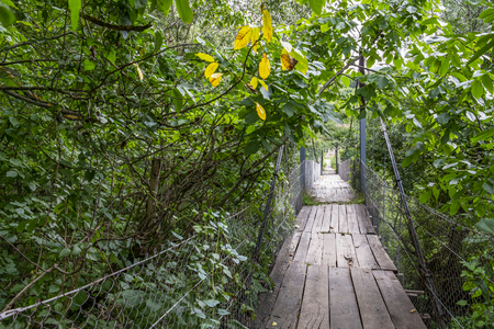 Old suspension footbridge in the Bulgarian Fore-Balkan village of Debnevo Stock Photo