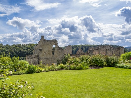 View to the ruins of Larochette Castle above the town of Larochette, Fiels or Fels in Luxembourg against a dramatic cloudy August sky Фото со стока
