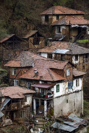 Elevated view to old poor houses in the village of Pirin in Pirin Mountains, Bulgaria