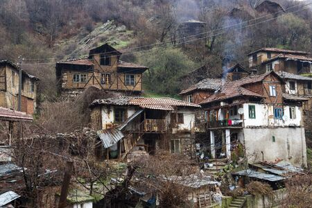 View to old poor houses in the village of Pirin in Pirin Mountains, Bulgaria Banco de Imagens