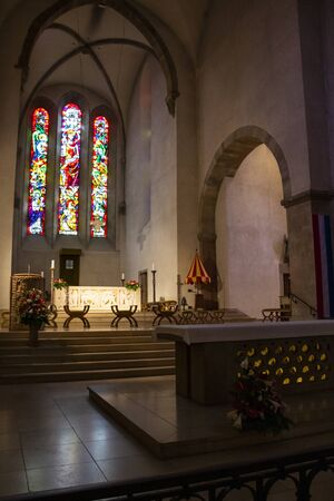 ECHTERNACH, LUXEMBOURG - MAY 25, 2016: Interior choir view with stained glass windows in Abbey's Basilica of St. Willibrord in Echternach, the oldest town in Luxembourg
