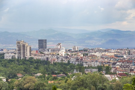 Elevated distant view of Sofia - the capital of Bulgaria from the area of the Botanical Garden, Vitosha Mountain in the background