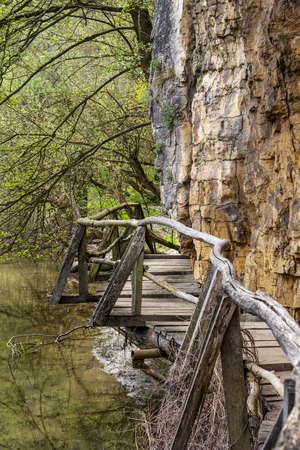 Elevated wooden walkway along Zlatna Panega River at Iskar-Panega Eco-path Geopark, the first geopark in Bulgaria
