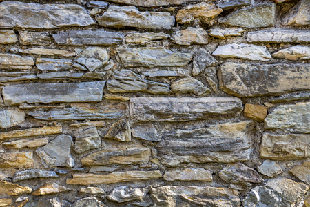 Old stone fence texture background in the Bulgarian village of Krepost, Haskovo Province