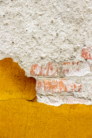 Old damaged yellowish exterior wall coating of an old abandoned building in Sofia, Bulgaria chipping off, texture background 版權商用圖片