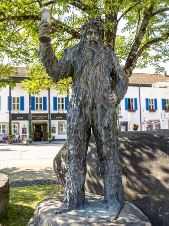 OBERSTDORF, GERMANY - JULY 01, 2015: The bronze Wilde-Maendle statue or statue of the Wild Man on a sunny summer day Sajtókép