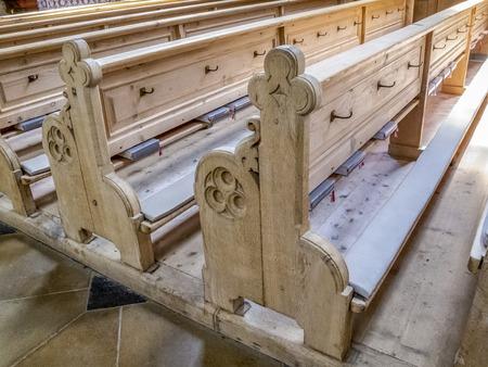 Empty wooden pews in St. John the Baptist Church in Oberstdorf, Bavaria Germany
