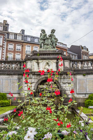 View of Cascade Monumentale in Spa, Belgium with flowers in the foreground Banco de Imagens