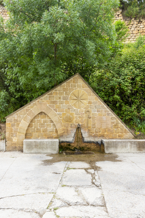 A pilgrim fountain in Estella or Lizzara, Navarre Spain, Calle Curtidores or Curtidores Street on the Way of St. James, Camino de Santiago