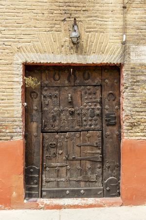 Heavily decorated old wooden door in Estella or Lizzara, Navarre Spain