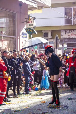 XANTHI, GREECE - MARCH 10, 2019: A male carnival parade participant dressed as a woman