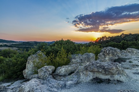 The sun setting over the Stone Mushrooms near Beli Plast village, Kardzhali Municipality, Bulgaria Stock Photo