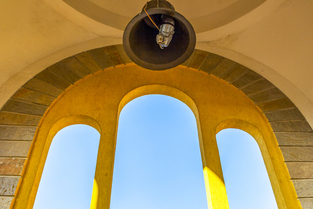 Architectural detail from the bell tower of Haskovo, Bulgaria with a church bell