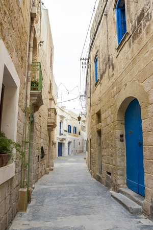 Beautiful typical narrow street in Rabat, Malta, streetscape detail