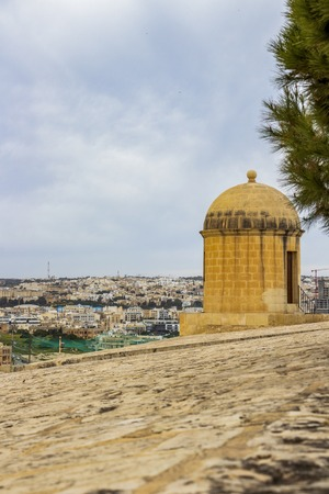 Hastings Gardens watch tower over the city of Valletta, Malta