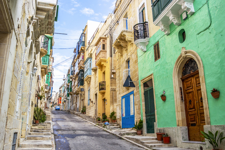 Beautiful colorful narrow lane with typical Maltese architecture in Cospicua - one of the Three fortified Cities of Malta