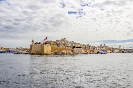 Mediterranean Sea view to Senglea, Malta under overcast March sky