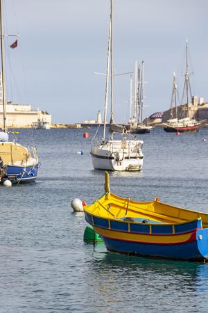 A Luzzu boat - the traditional Maltese fishing boat, at Sliema Creek, Malta Stock Photo