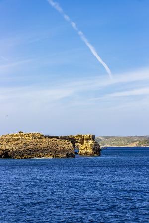 Mediterranean Sea view of a Comino Island natural arch