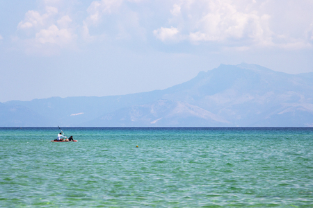Paddleboarding at Ammolofoi Beach, Kavala Region, Northern Greece