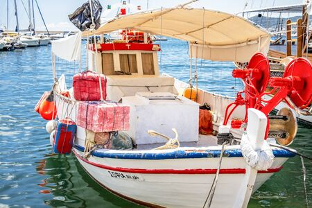 KAVALA, GREECE - JULY 20, 2018: Beautiful old weathered fishing boat at the Port of Kavala, Eastern Macedonia, Northern Greece, close picture