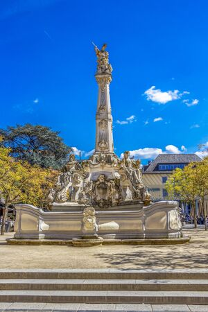 TRIER, GERMANY - MAY 04, 2016: The sunlit Rococo Sankt Georgsbrunnen or St. George's Fountain at the Kornmarkt Editorial