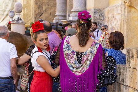 CORDOBA, SPAIN - MAY 30, 2019: Beautiful dressed female participants at Feria de Cordoba, Feria de Nuestra Senora de la Salud or Cordoba Fair